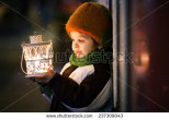 stock-photo-cute-boy-holding-lantern-outdoor-wintertime-237309043